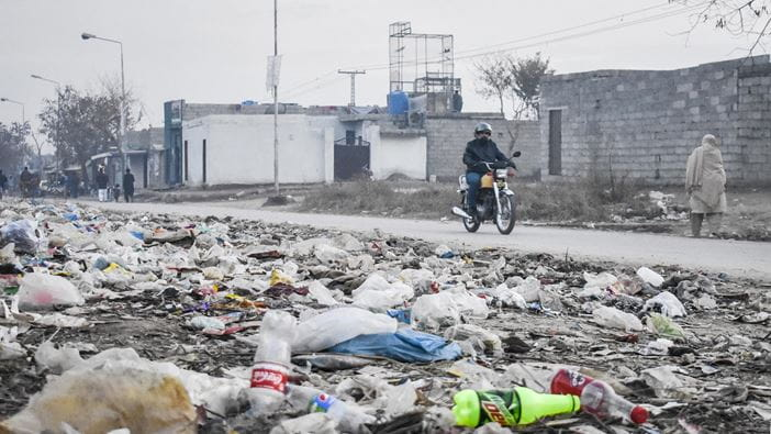 Coca-cola and Pepsi bottles among other plastic waste.