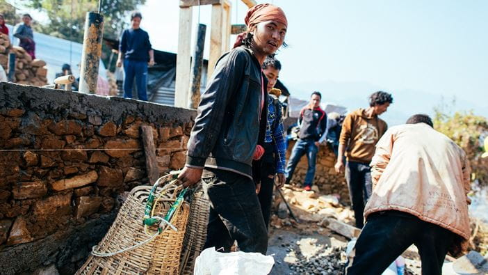 Local people work to rebuild homes after the Nepal earthquake