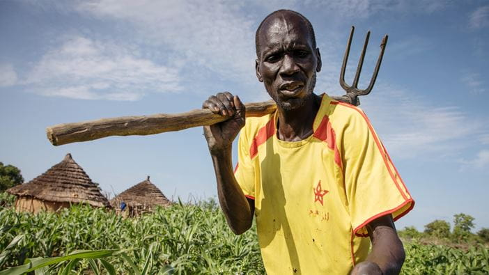 A farmer works in his field in South Sudan