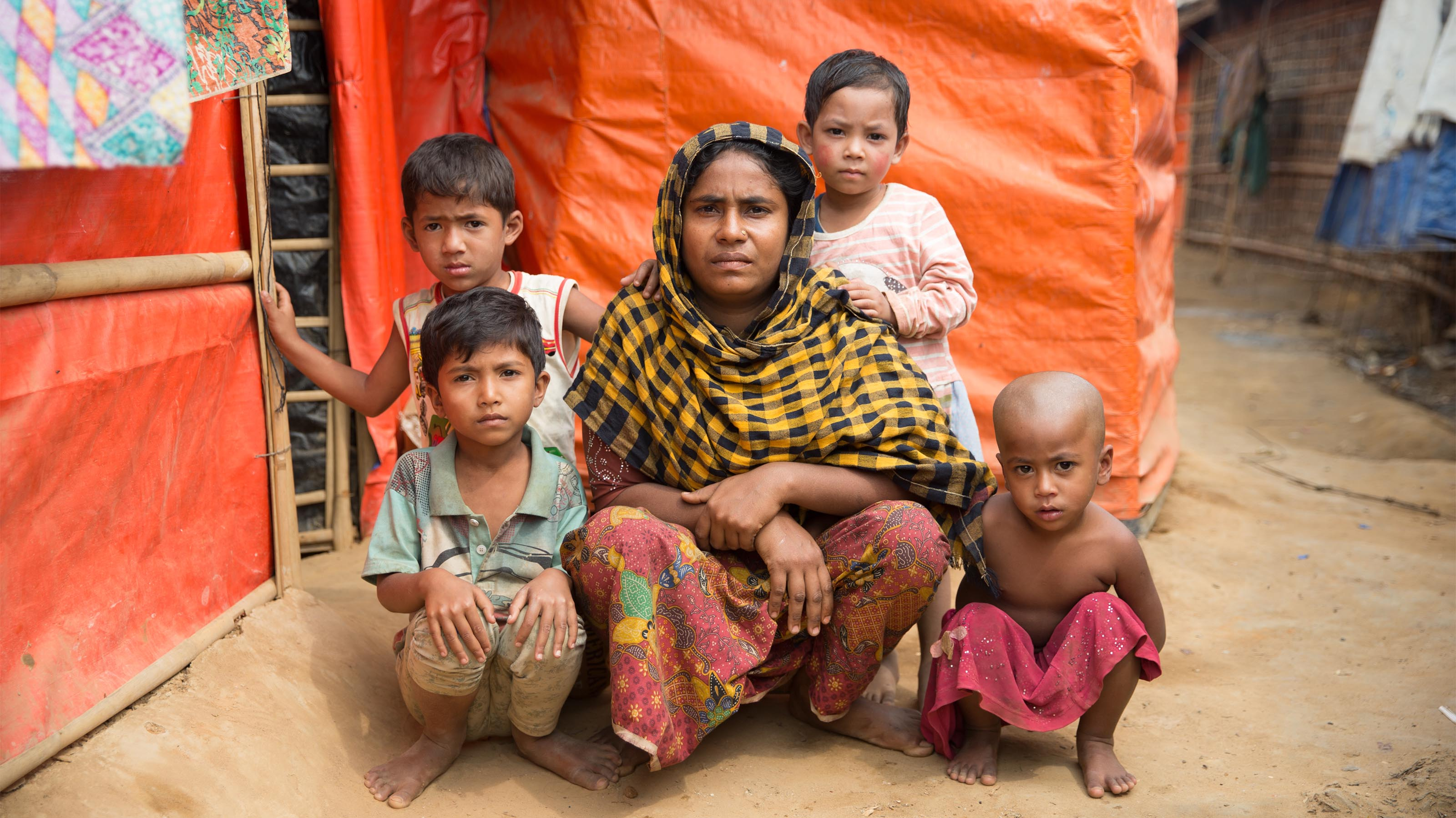 Mother and her children outside their tent in Rohingya refugee camp
