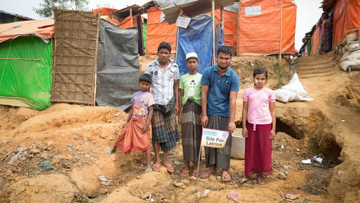 Rohingya refugees marking spot for placement of latrines provided by Tearfund