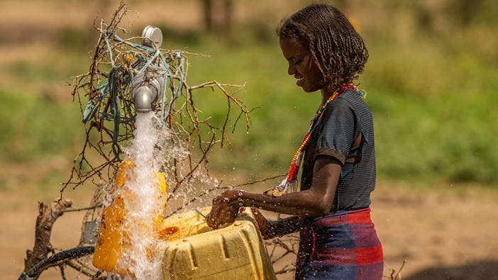 A member of the local community gathers fresh, clean water in Ethiopia