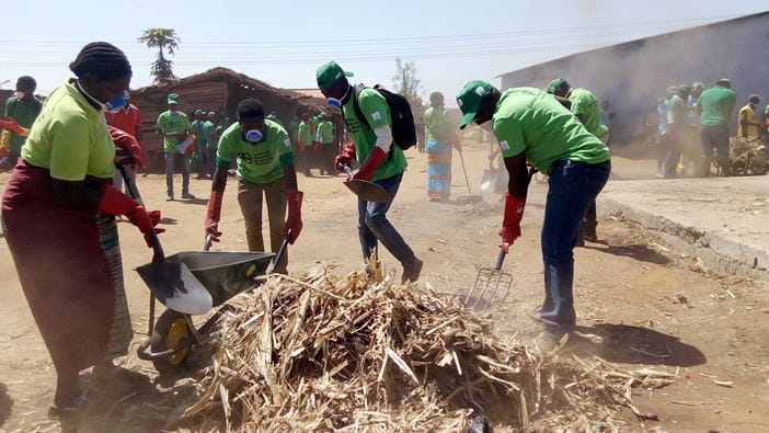 Community members in Mozambique mobilise to clean up the streets after hurricane Idai